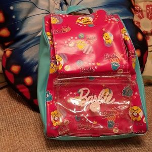 Barbie backpack and animal inside